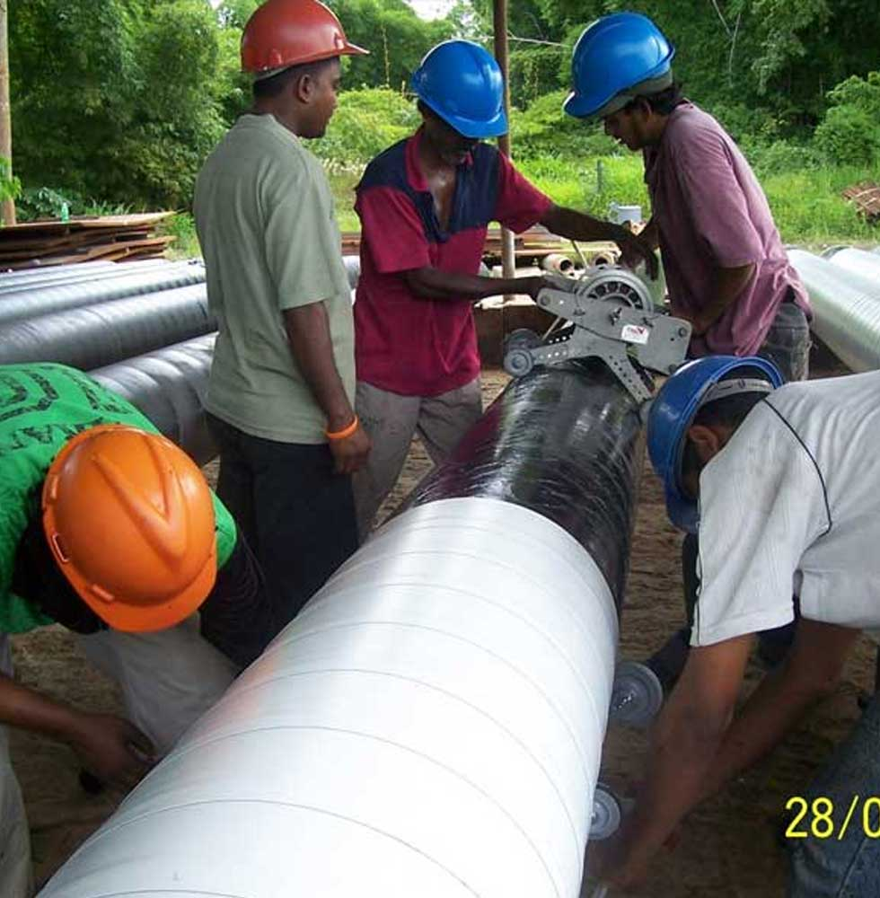 workers cutting a pipe